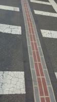 De strook met rode bakstenen wijst je de weg langs het Freedom Trail